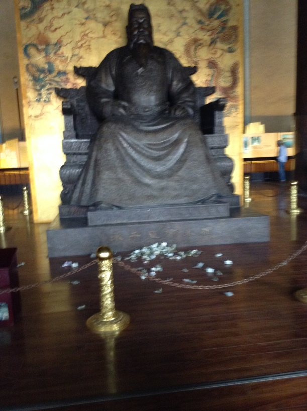 Emperor Yongle with money offerings at his feet. This money is collected and used to maintain the building